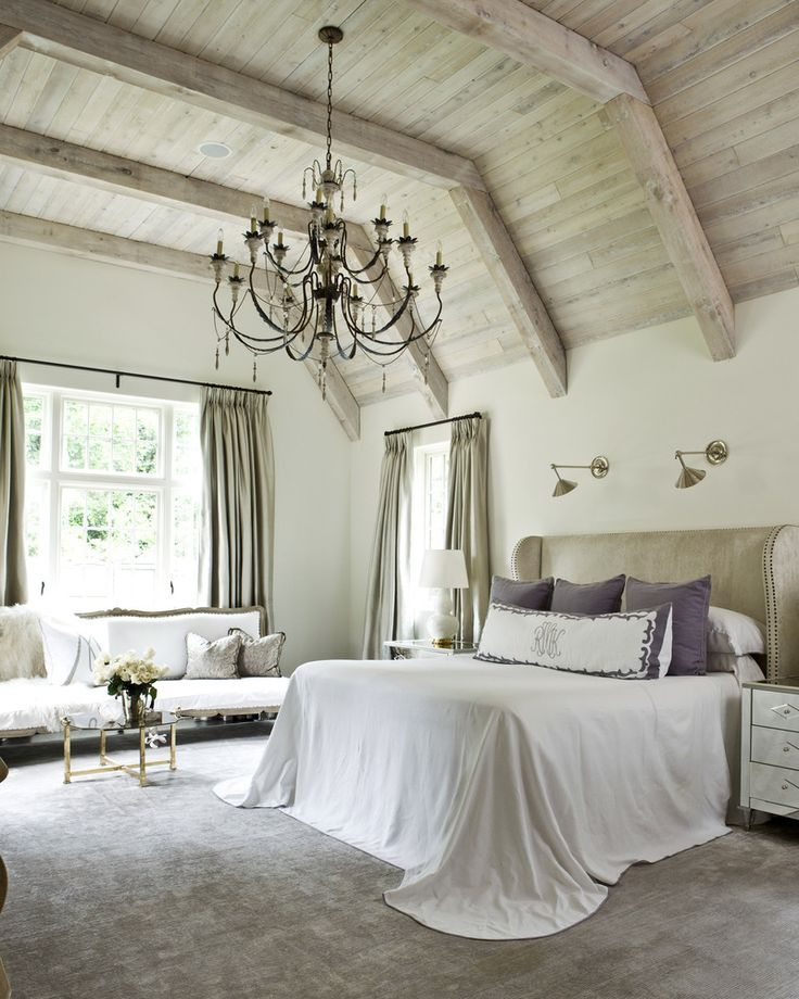 """Atlanta-based Suzanna Kasler emphasizes the notion of """"collecting"""" over """"decorating."""" We love how she added drama to this elegant bedroom with an oversized chandelier."""