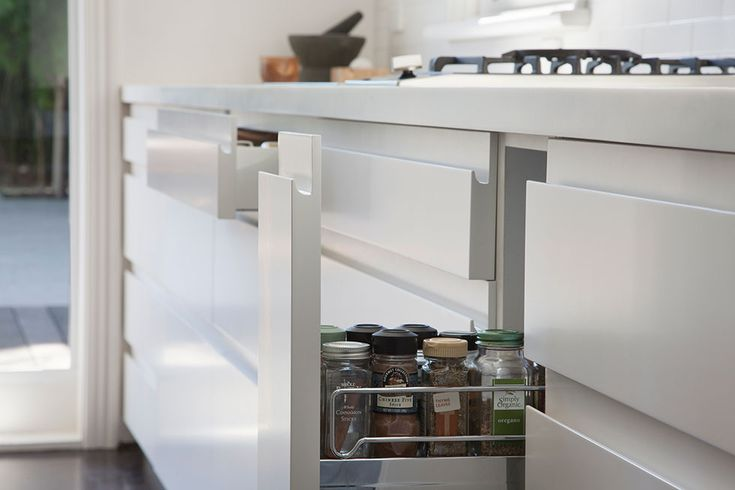 Detail of matte finish cameo white corian benchtop and finger groove in kitchen cupboards with painted natural white two pack paint finish | Glenderg Grove by Mihaly Slocombe (2015) | Malvern, Victoria, Australia | photo: Tatjana Plitt