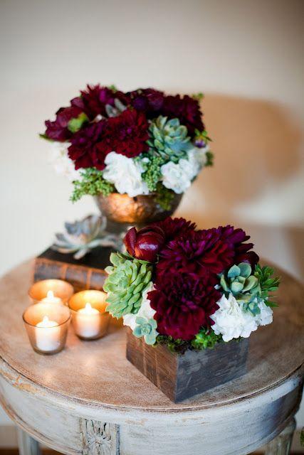 More burgundy/succulent pictures- we like these flowers choices not necessarily the arrangement and how overly burgundy this bundle is.