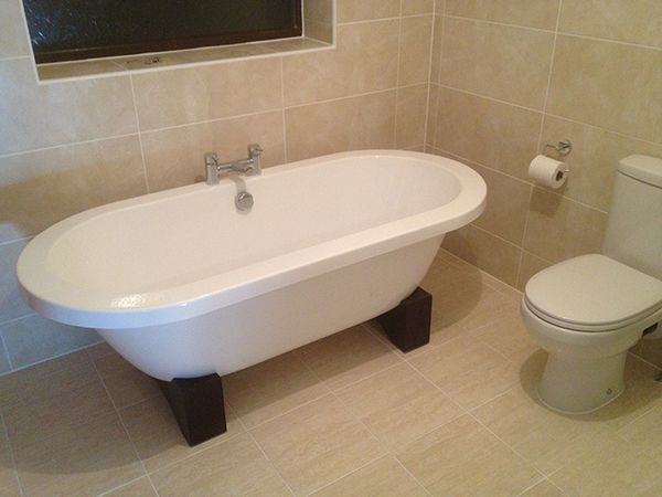 Images On Freestanding Bath Installation in a Bathroom Renovation Project by UK Bathroom Guru