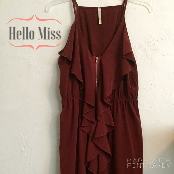 "Hello Miss Dress Very good condition burnt orange dress. Cascading ruffles adorn the front of this beauty. I am 5'9"" and this dress hit me mid to upper thigh. Hello miss Dresses"