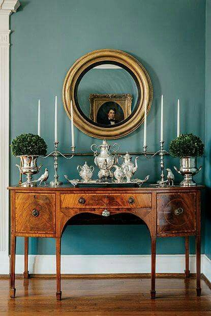 beautiful Farrow and Ball paint surrounds a handsome antique sideboard that is beautifully & elegantly styled!