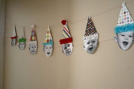 Cutest little baby face birthday banner.  See more first boy birthday decorations and party ideas at one-stop-party-ideas.com