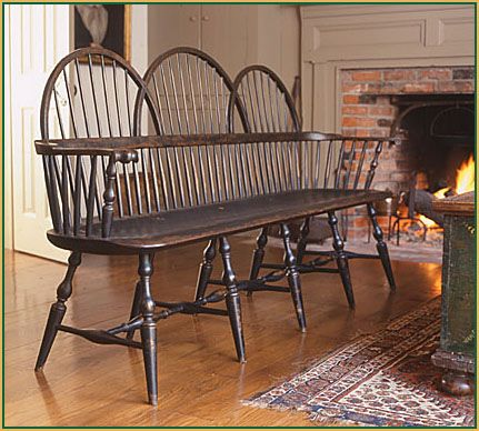 Triple Bow-back Settee by Richard Grell---that'd be nice by a front door in a long entrance hallway or something...i can picture taking off winterboots haha