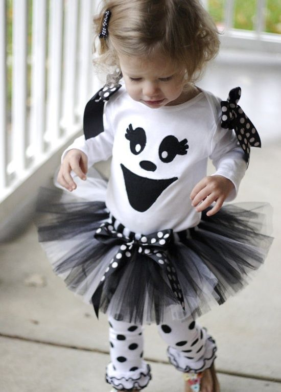 Too cute! Once you have found a tutu tutorial, all you have to do is find a white t-shirt and white pants and add black face to shirt with fabric or permanent marker and polka dots to the pants. Add cute bows and wah-la!