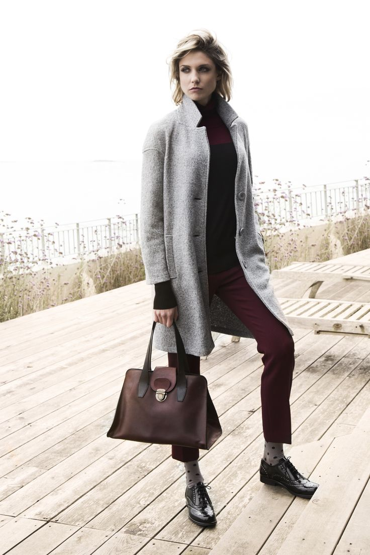 Boiled wool coat, burgundy cropped pants and leather bag, all Carolyn Donnelly The Edit