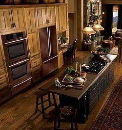 A copper hood would look great with bronze appliances ...