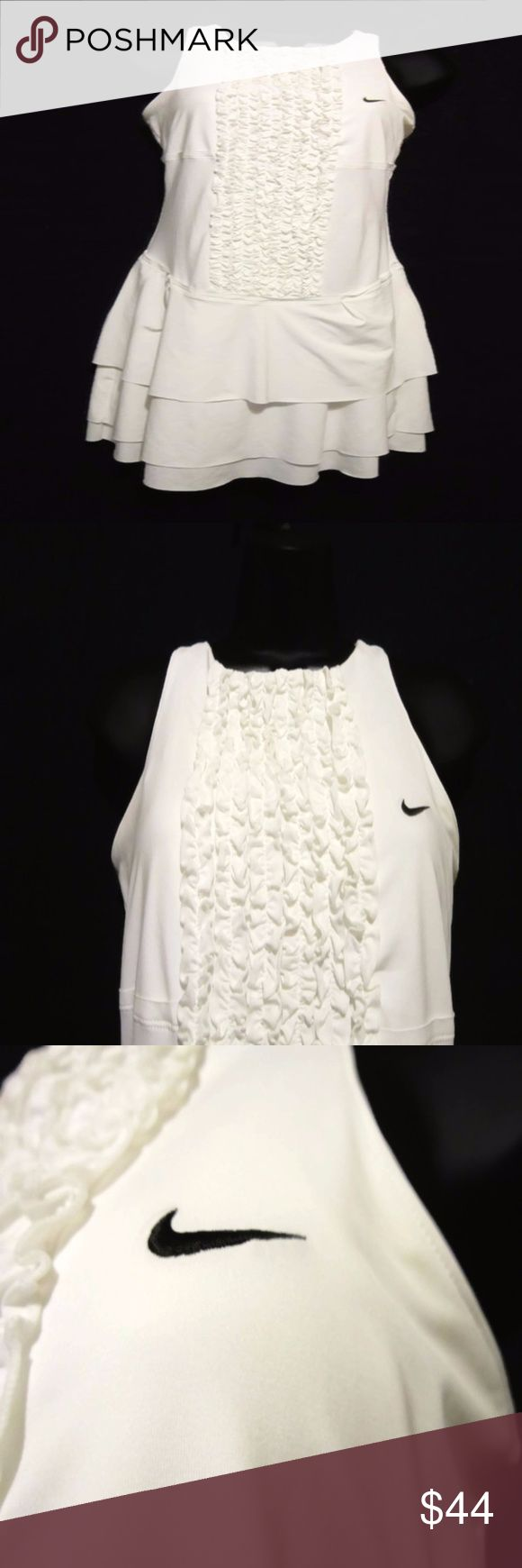 "Nike Wimbledon Grass Court Ruffled Tiered Dress Feminine Athletic Apparel  Tiered Hem Ruffle Front Nike Logo  Racerback  White   Full 14% Spandex for Comfort Stretch  High Quality Nike 348334-100  Womens Size XS Measures Armpit to Armpit 15"" Length Shoulder to Hem 32""  Excellent Pre-Owned Condition  Cute and Feminine Athletic Apparel!!  Smoke Free Environment Nike Dresses"