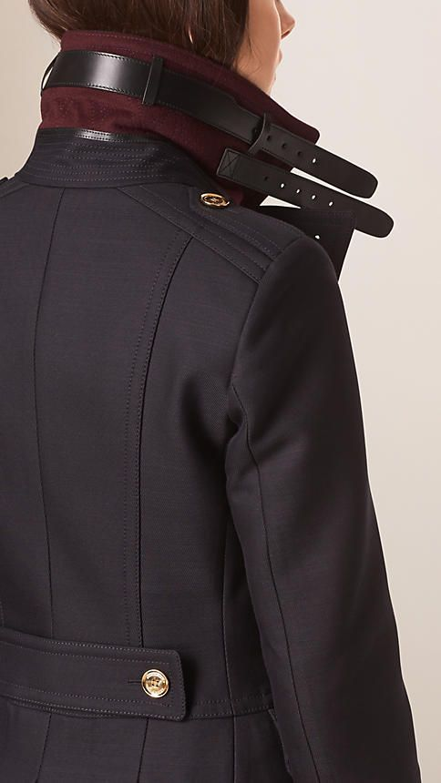 A Burberry military coat in a sculptural cotton and wool blend with a wide revere collar and leather throat latch. Discover the women's outerwear collection at Burberry.com #womenscardigan #womensouterwear #womensjacket