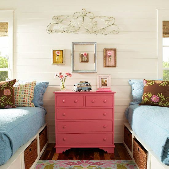 Small Kids' Bedrooms  Problem: A shared room with lots of stuff.  Solution: For a shared room, try shared furniture. In this girls' room, a dresser positioned between two twin beds doubles as a nightstand for both beds. WHAT I LIKE ABOUT THIS IS THAT IT ALSO GIVES AN IDEA TO KEEP BOXES TOGETHER TO CREATE A BED AND ALSO HAVE BASKETS UNDERNEATH.