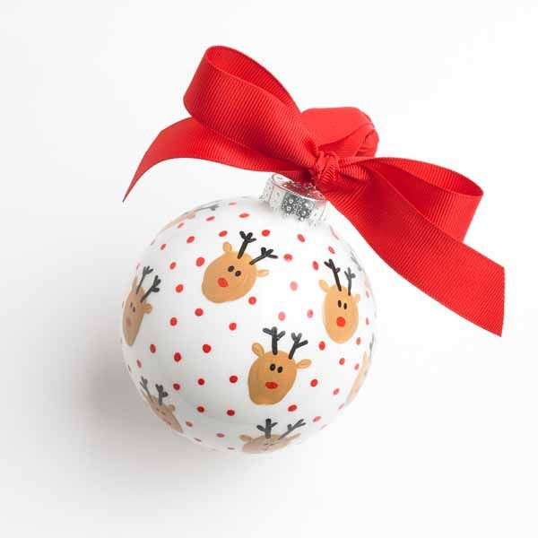 Adorn your tree with this cute fingerprint reindeer ornament, perfect for Christmastime crafting with the kids.