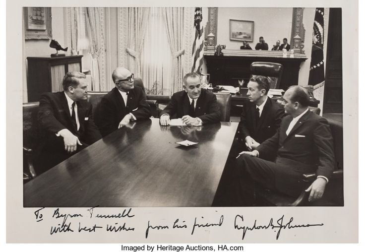 The photograph, taken the day after President Kennedy's assassination, pictures (from left to right): George Christian, press secretary for Texas Governor John Connally ; Preston Smith, Lt. Governor of Texas; Lyndon Baines Johnson; Waggoner Carr, Attorney General of Texas; and Byron Tunnell, Speaker of the Texas House of Representatives. The newly sworn-in Johnson had summoned the Texas officials to Washington to help plan Kennedy's funeral.