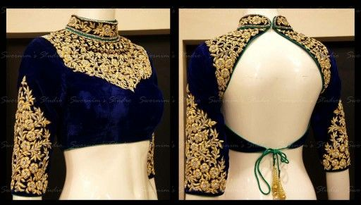 Designer blue blouse with attractive zari work.love the sleeves.... but not the back!