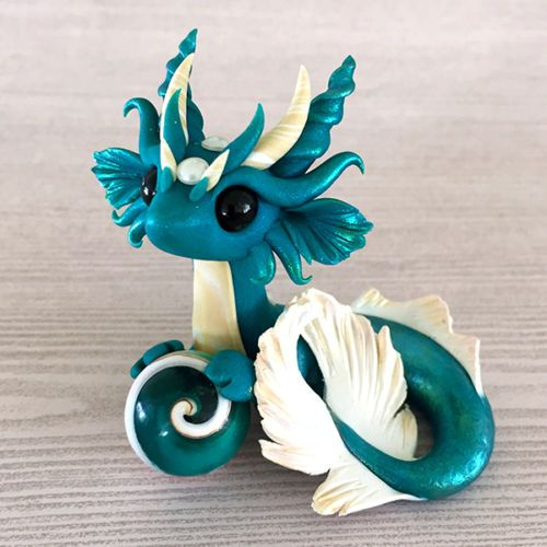 Teal-and-Gold-Mer-dragon-Sculpture-by-Dragons-and-Beasties