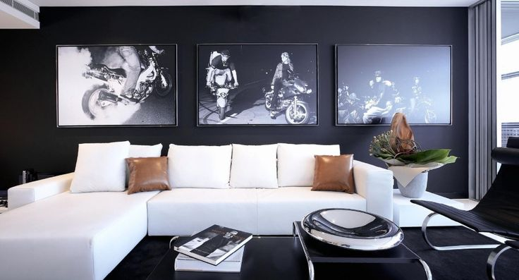 Apartment, L Shaped White Sofa Five White Cushions Brown Leather Cushions Black Metal Coffee Table Black Lounge Chair Black Wall Three Photo Frames Square White End Table Black Fur Rug White Flowerpot: Best Designing Ideas For Your Studio Type Apartment
