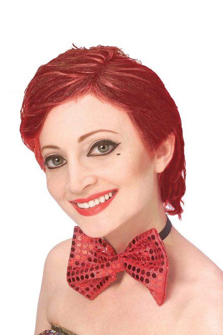 Join in on the cult fun with this officially licensed Columbia wig from the movie 'Rocky Horror Picture Show.' The wig is made with auburn synthetic hair. Dress up as Columbia for Halloween or Movie screenings.