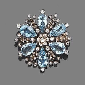 An aquamarine and diamond brooch,