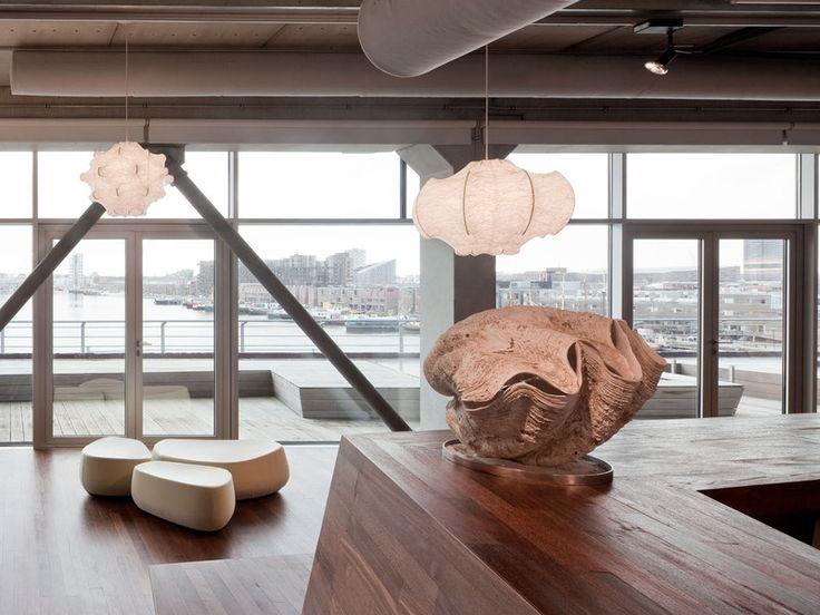 The Viscontea Suspension Light, designed by Achille  Castiglioni and Pier Giacomo Castiglioni, is fun lighting structure that offers soft, diffused light.