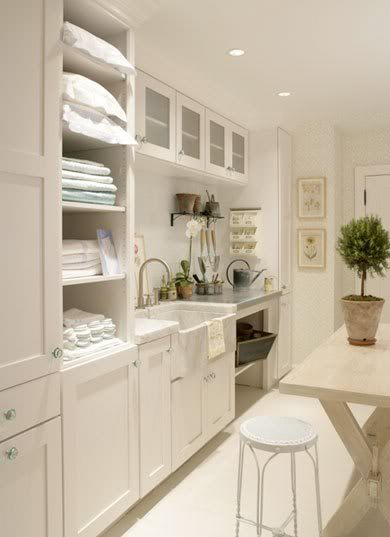 White laundry room, cupboards, open shelves , sink and glass handles