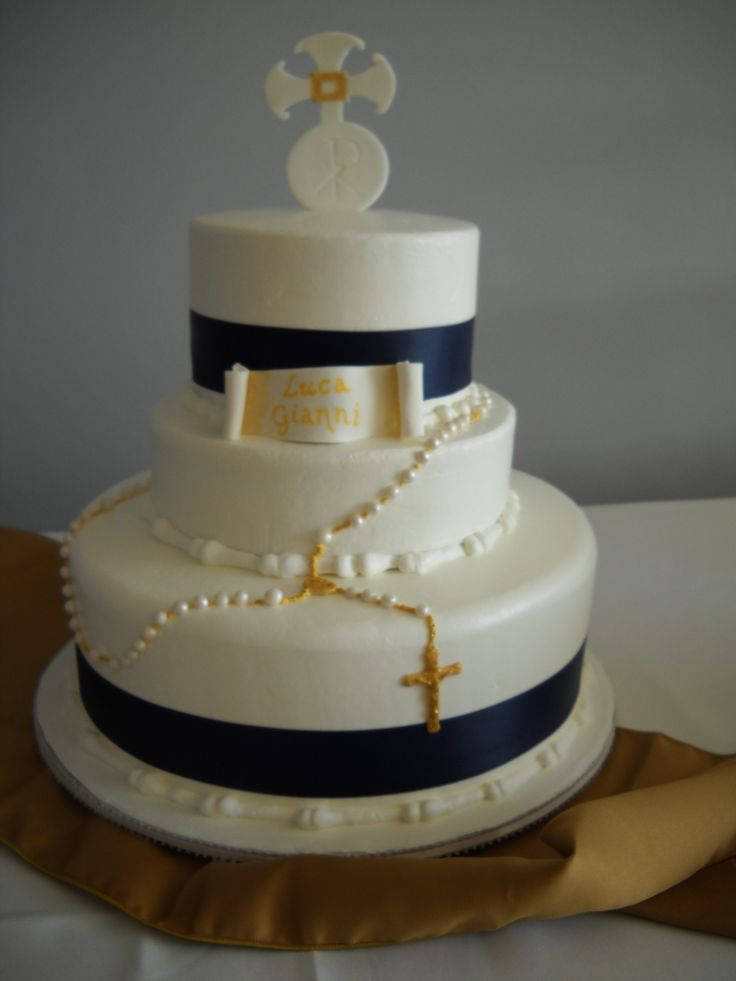 First Communion cake for boy.  Rosary, crosses, host and plaque all made of fondant.