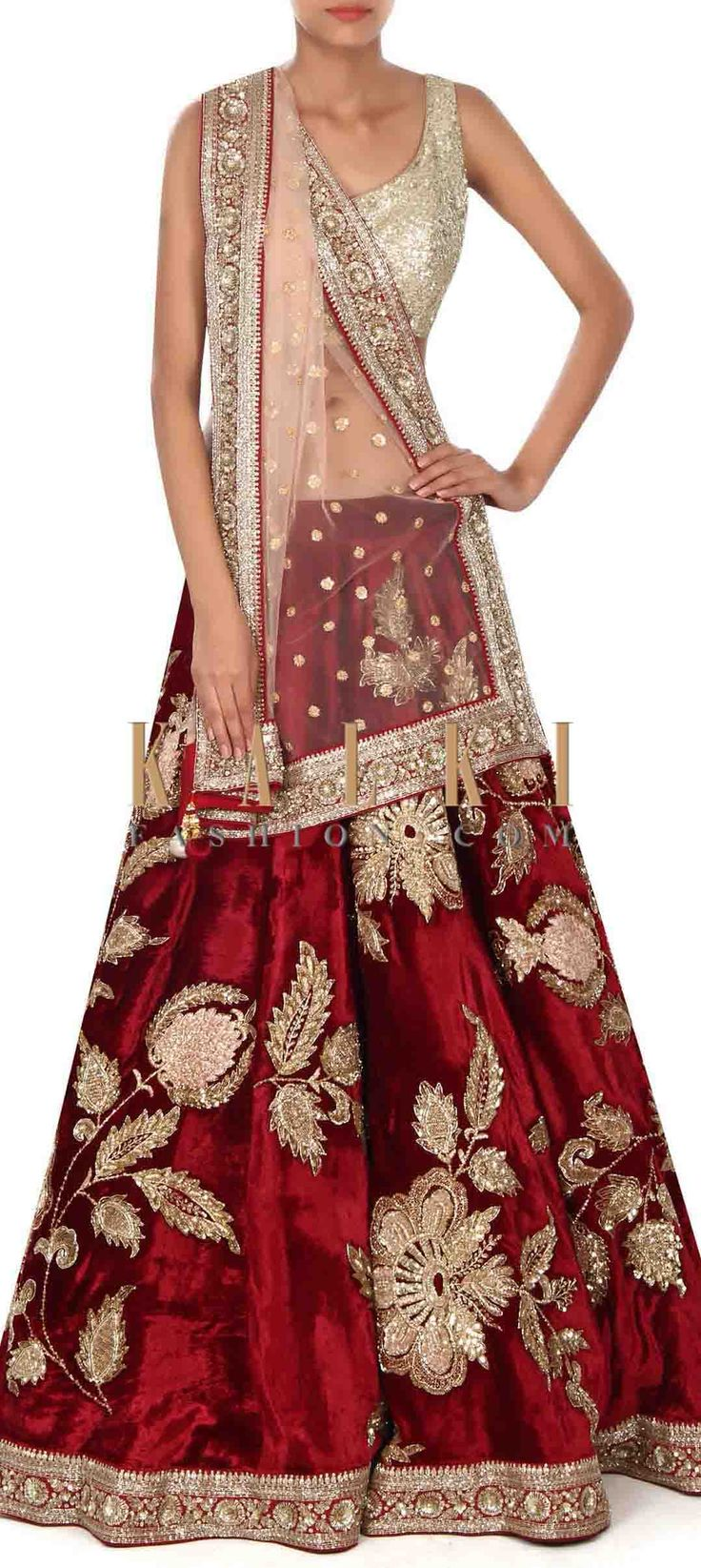 Buy this Wine lehenga adorn in zari in floral motif only on Kalki