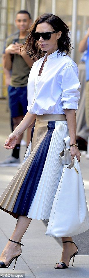 Victoria Beckham wearing a shirt & skirt from her Spring / Summer 2017 collection.