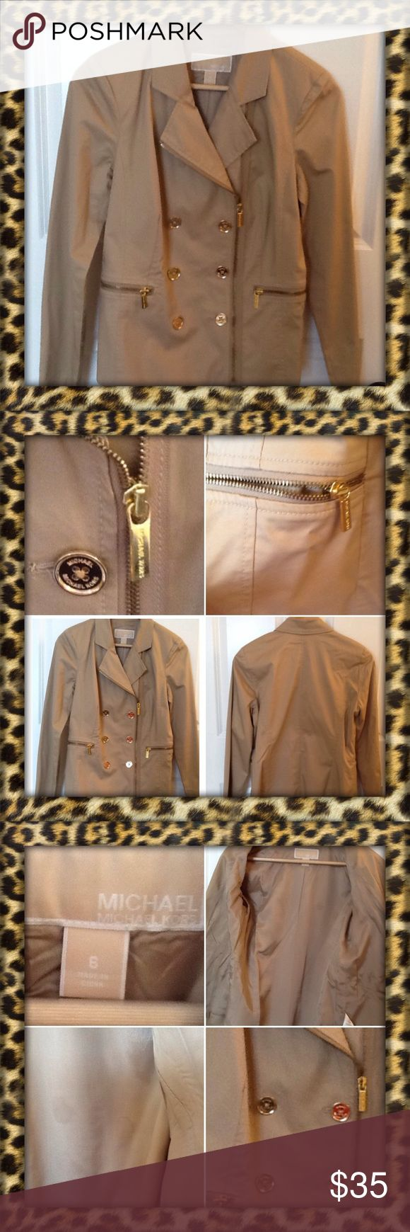 Michael Kors blazer Michael by Michael Kors Safari inspired double breasted blazer with gold buttons and zippers; pockets are functional; worn 1x; no rips; 2 small water stains in the lining (see photo) not noticeable when wearing MICHAEL Michael Kors Jackets & Coats Blazers