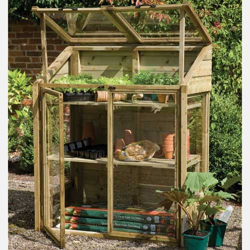 Forest Garden Mini Greenhouse shown with hinged lid - made for the tiny space I have! It's like it was made for us :)