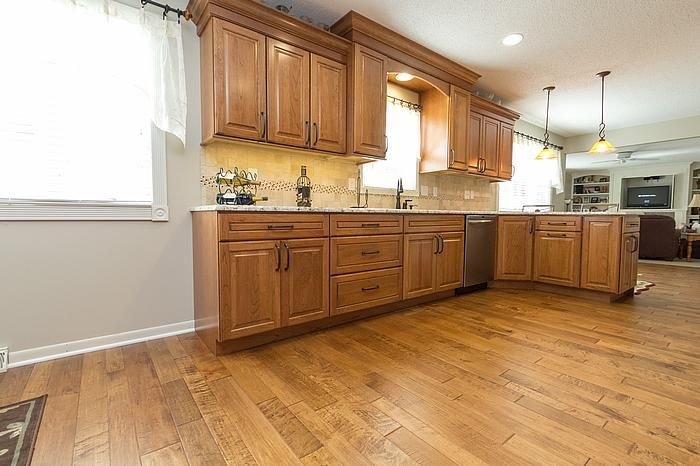 Designers laura cabinets countertops bill flooring for Butternut kitchen cabinets