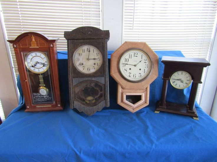 """4 clocks including a 23""""T antique Japanese wall clock; a vintage New Haven 19""""T wall clock; a modern bicentennial shelf clock, 21.5""""T, made in Korea; and a modern 15""""T battery operated clock."""