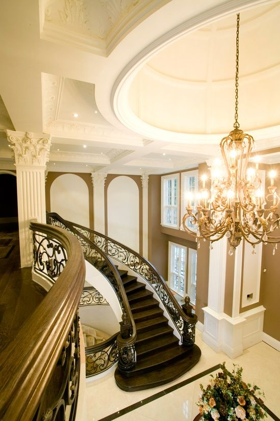 Beautiful staircase and chandelier great for entrance as for House plans with stairs in foyer