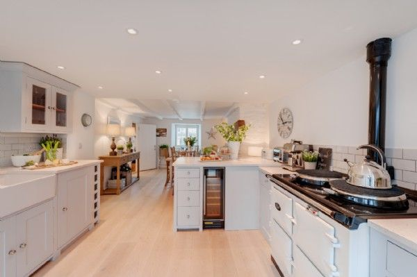 Open plan kitchen and dining room with electric Aga