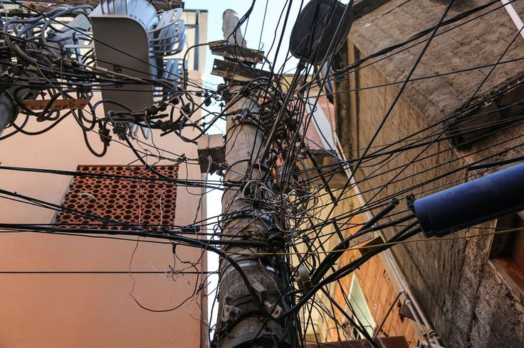 """You'll find clandestine electricity connections like these all over Rio with residents illegally harvesting electricity through what they call """"gatos"""" (or cats). They are the scurge of energy suppliers across the country, though also a sign of the locals' ingenuity."""