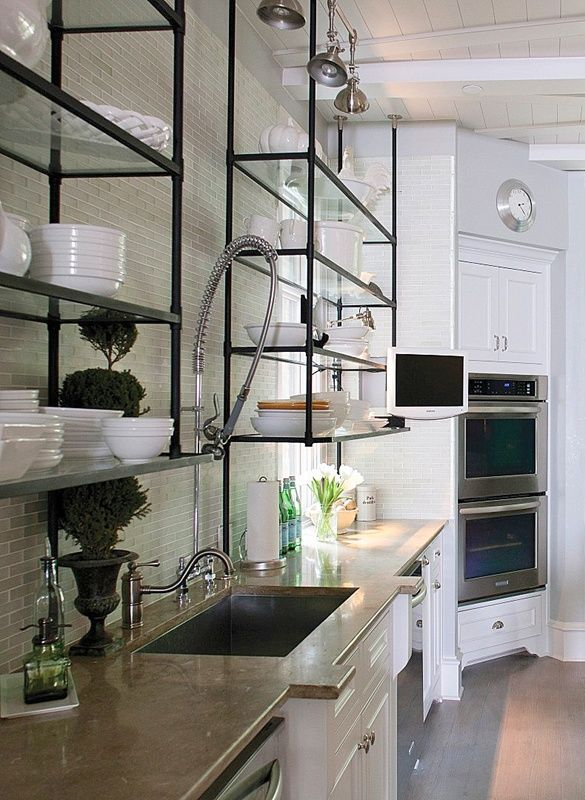 Kitchen inspiration - Love the aged metal and glass shelves, white cabinets, and white dinnerware in this vintage modern kitchen design.