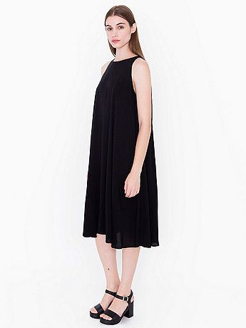 Oversized calf-length dress featuring a loose-waistline and high-neckline sleeveless design, constructed from our soft Rayon fabric.