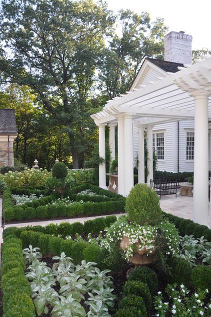 White pergola. There's really nothing like a well-built pergola to offer shade and respite outdoors. If your home is white, consider a matching pergola — a bonus room from which to enjoy the view. Flank it with silver and white plants, framed in a classic boxwood parterre for classical elegance.
