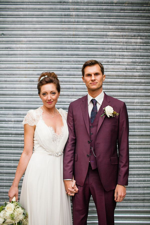 Groom in plum/purple/damson colour Paul Smith suit, bride wearing Dentelle by Jenny Packham.  Photography by http://www.emmacasephotography.com/