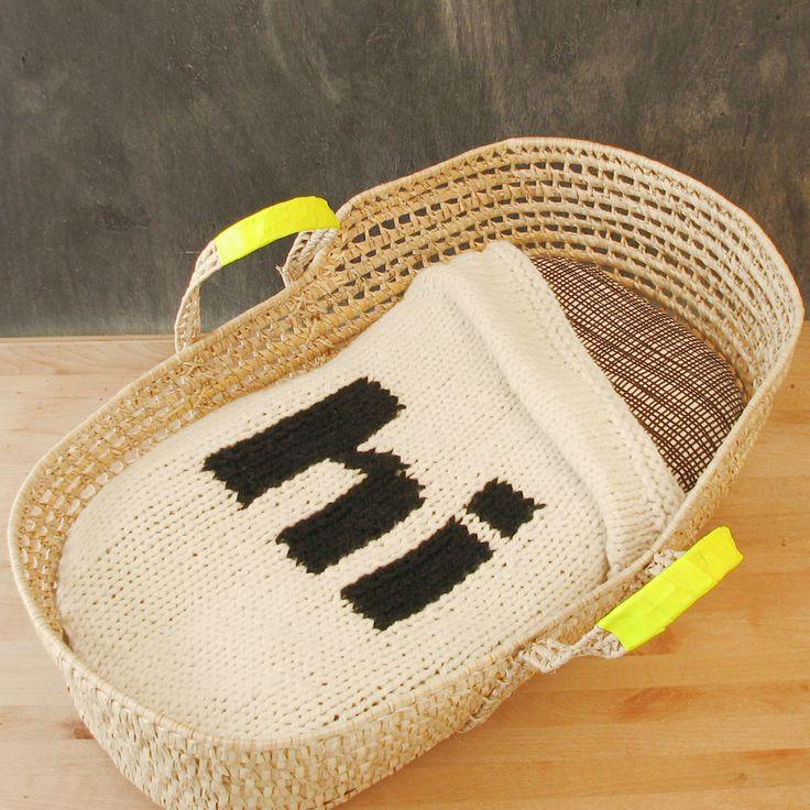 knitted Helvetica 'hi' baby blanket