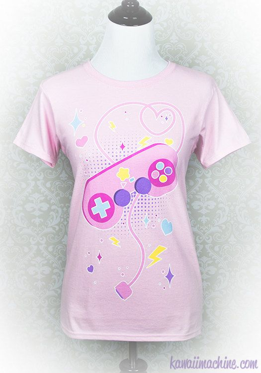 The majority of my spare time in life has been spent playing games, so I wanted to make a super cute tee reflecting my lifelong love. This tee features a pastel retro inspired game controller surrounded by hearts, lightning bolts, stars, and hearts.  My design is professionally printed by default on a womens Gildan 100% cotton classic relaxed fit tee.  Prefer a unisex fit, slim fit, or tank top instead? Check out the upgrade options available here…