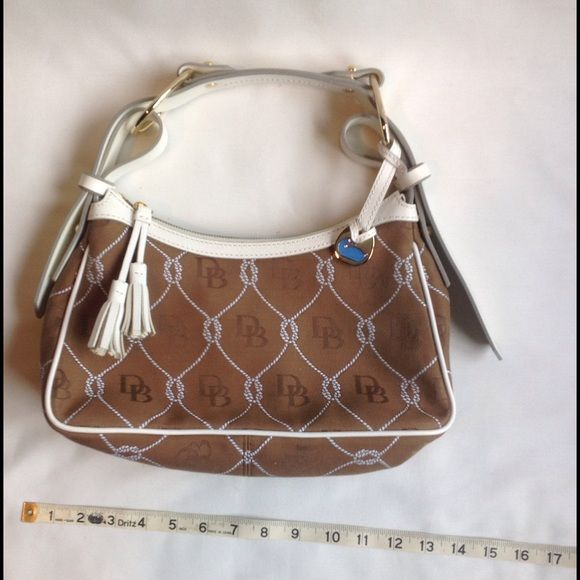 NEW! Dooney & Bourke Gold Purse Dooney & Bourke gold and cream purse  Brand New! Never worn! 100% Authentic! Bag ID #J6374452  Comes from a large collection of purses bought from outlets all over the east and south coast. Dooney & Bourke Bags Shoulder Bags