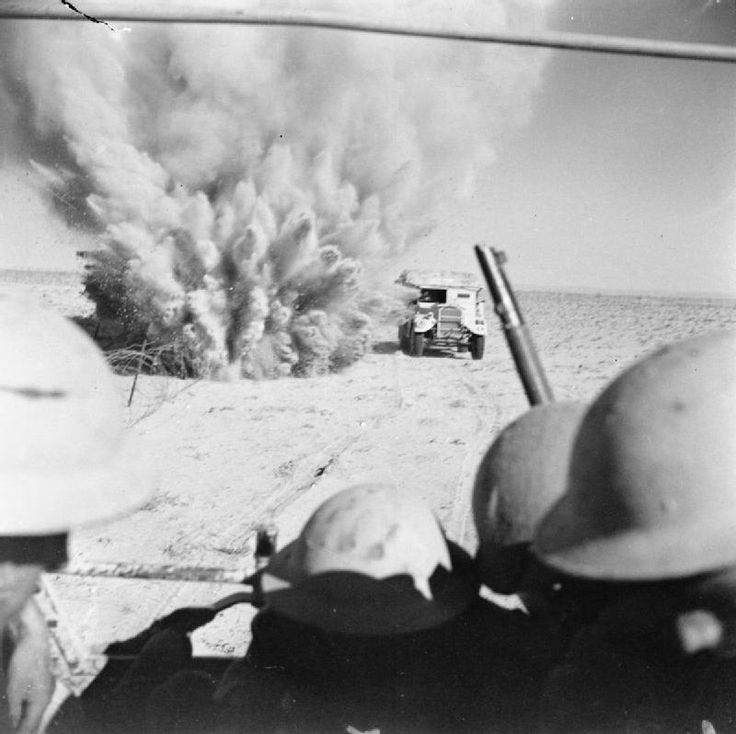 October 1942. A mine explodes close to a British artillery tractor as it advances through enemy minefields and wire to the new front lines.