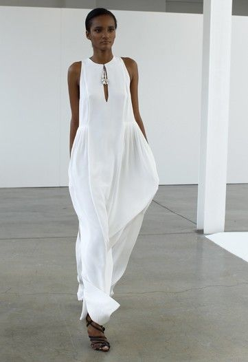 Emilio Pucci. So gorgeous against her skin tone!  I feel like she should be on a river cruise or sunning in Ibiza...