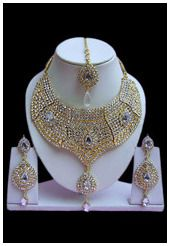 White imitation necklace set designed with stone and beads. Matching pair of earring and mangtika comes along with this.