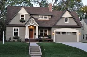 Warm gray with white trim and brown roof. Like the orange