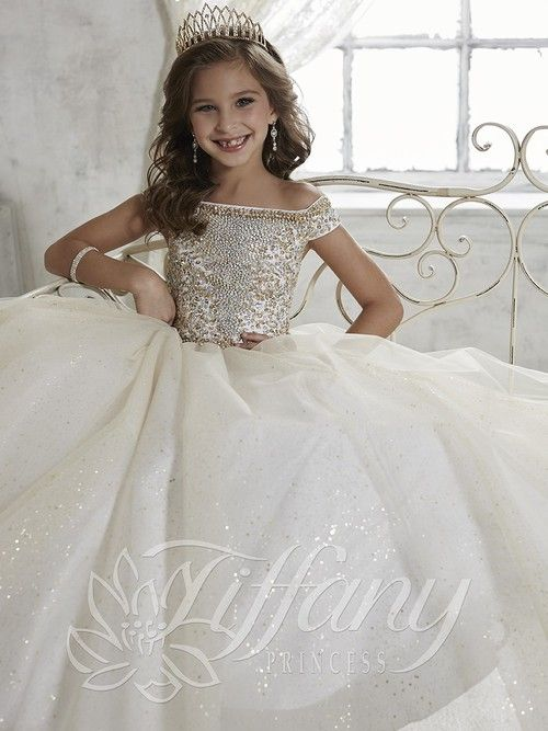 Tiffany Princess Glitter Tulle Pageant Gown 13457 is every young lady's dream princess dress and a sure winner. Girls Pageant Dress is simply stunning!