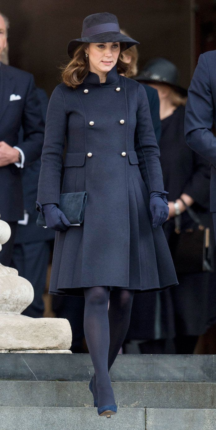 Pregnant Kate Middleton Covers Her Bump in a CH Carolina Herrera Coat | Kate Middleton paid her respects to the victims of the Grenfell Tower fire in a custom military-inspired navy coat.