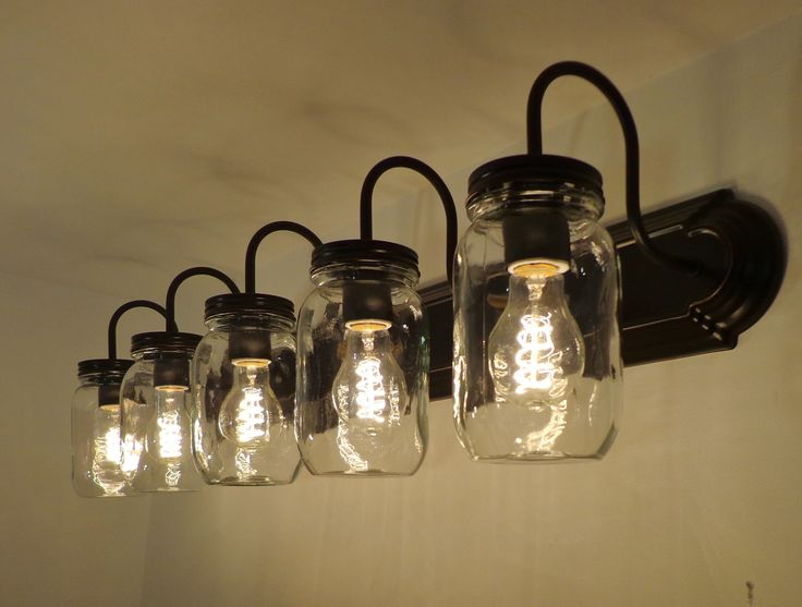 "Here's your answer to loads of illumination over your bathroom sink! FIVE bulbs all at 60 watts! * 36"" Wide x 4.75"" High Backer Plate * (5) Clear Heavy Quart Mason Jars * Projects 9"" out from the wall"