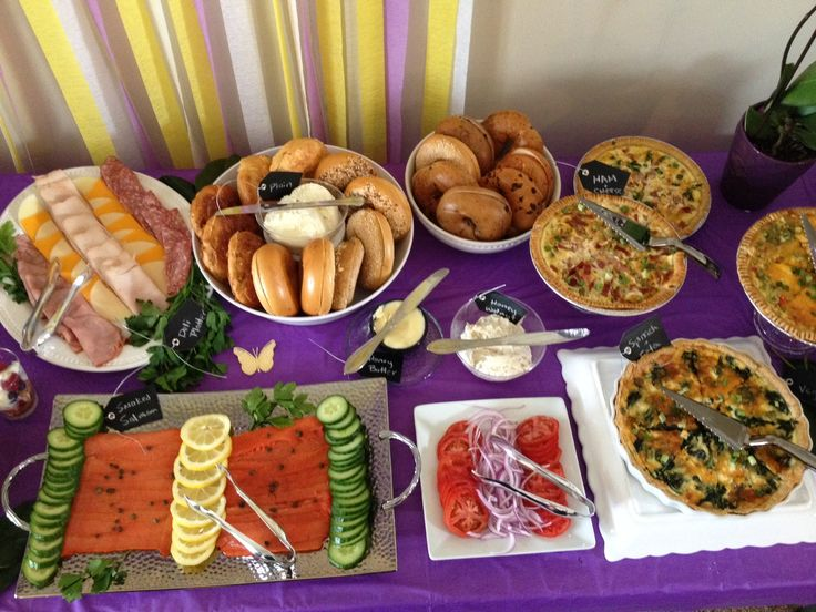 Brunch Birthday party table layout. Bagel bar with deli platter and smoked salmon, quiches of different varieties.