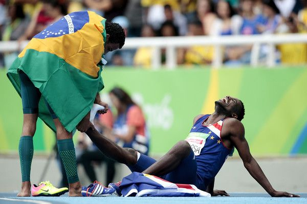 (L-R) Daniel Martins of Brazil helps Gracelino Barbosa of Cape Verde after the Men's 400m - T20 Final at the Olympic Stadium on Day 2 of the Rio 2016 Paralympic Games on September 9, 2016 in Rio de Janeiro, Brazil.