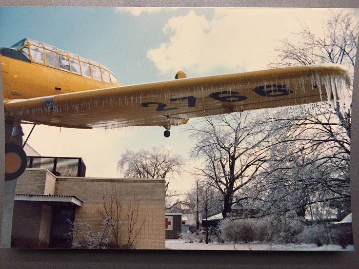 Harvard Mark II after an ice storm circa 1988 in Dunnville, Ontario in front of the library.  Main plaque: HARVARD MARK II  THIS AIRCRAFT, A NORTH AMERICAN HARVARD MARK II, WAS THE PRINCIPAL SECONDARY TRAINING AIRCRAFT USED BY THE R.C.A.F. DURING THE SECOND WORLD WAR, 1939-1945.  2,436 BRITISH COMMONWEALTH PILOTS RECEIVED THEIR SERVICE FLYING TRAINING ON THIS TYPE OF AIRCRAFT AT NO. 6 SERVICE FLYING TRAINING SCHOOL, R.C.A.F. DUNNVILLE, FROM OCTOBER 31ST, 1940 UNTIL DECEMBER 1ST, 1944. ...
